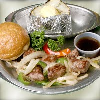 #3  5 oz. Grilled Sirloin Tips With Onions And Peppers or Brown Gravy $8.99