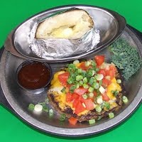 11 8 oz. Santa Fe Style Chopped Steak Smothered with 2 Cheeses Onions and Tomatoes $8.99